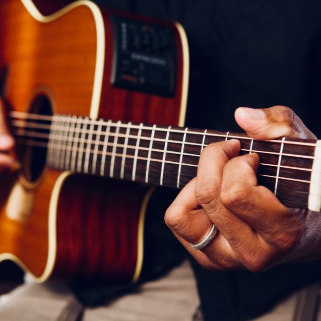 photo-of-person-playing-acoustic-guitar-1751731